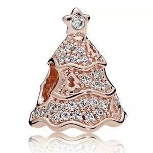 Pandora rose gold twinkling Christmas tree charm.